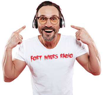 FTM  350px Fort myers radio t shirt man listening to music headphones pointing shutterstock_1054799690